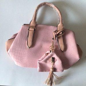 Pink satchel bag with straps.